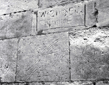Graffiti on the exterior of Totternhoe Church [Z50/127/9]